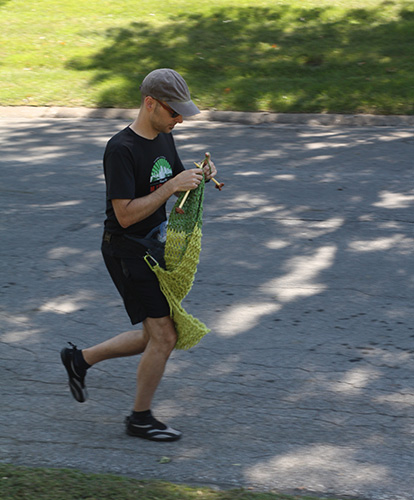 image of David running while knitting